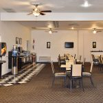 breakfast display with seating at Magnuson Hotel & Suites Alamogordo