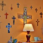 crosses hung on orange wall in lobby