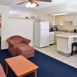 suite with kitchenette, arm chair, and sofa at Magnuson Hotel & Suites Alamogordo